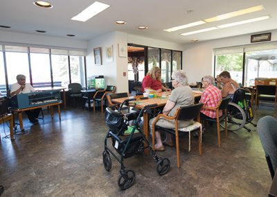 residents playing cards in common area